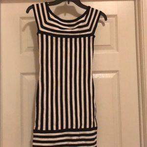 Bebe black and white stripe body con dress.